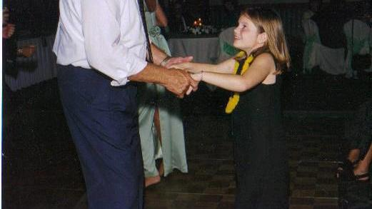 Grandpa Bob dancing with 9-year-old Caitlin